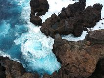 Aerial top view of sea waves hitting rocks on Tenerife, Canary islands stock photo