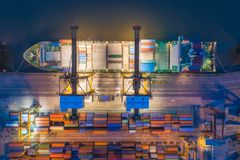 Aerial top view of ship containers at shipping port for international import or export logistics or transportation business. Concept background royalty free stock photography