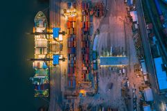 Aerial top view of ship containers at shipping port for international import or export logistics or transportation business. Concept background stock photos