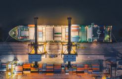 Aerial top view of ship containers at shipping port for international import or export logistics or transportation business. Concept background royalty free stock photos