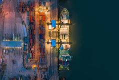 Aerial top view of ship containers at shipping port for international import or export logistics or transportation business. Concept background royalty free stock image