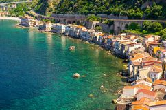Aerial top view of small fishing village Chianalea di Scilla, It. Aerial top view of houses in small fishing village Chianalea di Scilla from old medieval castle stock photography