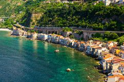Aerial top view of small fishing village Chianalea di Scilla, It. Aerial top view of houses in small fishing village Chianalea di Scilla from old medieval castle stock image