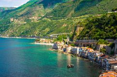 Aerial top view of small fishing village Chianalea di Scilla, It. Aerial top view of houses in small fishing village Chianalea di Scilla from old medieval castle royalty free stock photos