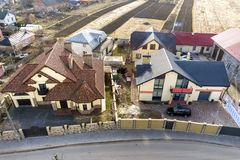 Aerial top view of suburb area with nice houses and cars on sunny day.  stock photography