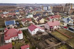 Aerial top view of suburb area with nice houses and cars on sunny day.  royalty free stock photography