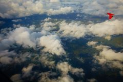 Aerial view of country side. Aerial top view of suburban district through the clouds Royalty Free Stock Photography