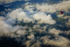 Aerial view of country side. Aerial top view of suburban district through the clouds Stock Images