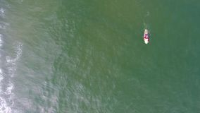 Aerial top view of surfing man in Hainan in China. Aerial top view of surfing man in Hainan, China Stock Images
