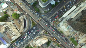 Aerial top view of traffic and vehicle car on crossroad or junction in bangkok city area at twilight sunset, 90 degree shot, High. Aerial top view of traffic and stock footage