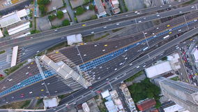 Aerial top view of traffic and vehicle car on tollway or express way in bangkok city area, transportation concept, 90 degree camer. A view shot , High quality stock footage