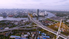 Aerial top view of traffic and vehicle car on tollway and expressway in bangkok city area near chao phraya river, transportation c stock footage