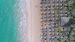 Aerial top view of tropical beach. People, umbrellas, chairs. Punta Cana, Dominican Republic.  stock footage