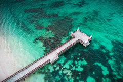 Aerial top view of tropical wooden pier and turquoise caribbean sea Stock Images
