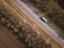 Aerial Top View of Truck with Cargo Semi Trailer Moving on Road in Direction stock photography