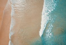 Aerial view to tropical sandy beach and blue ocean. Top view of ocean waves reaching shore on sunny day. Palawan, Philippines. Aerial top view of turquoise ocean stock photos