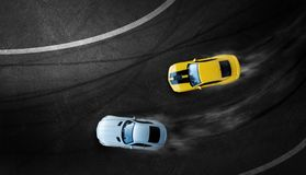 Aerial top view two cars drifting battle on race track. Two race cars view from above royalty free stock images