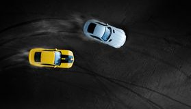 Aerial top view two cars drifting battle on race track. Two race cars view from above stock photo