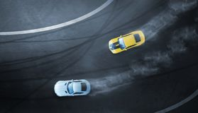 Aerial top view two cars drifting battle on race track. Two race cars view from above royalty free stock photos