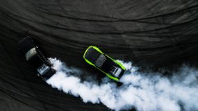 Aerial top view two cars drifting battle on race track, Two cars. Battle drift, Race cars view from above stock photo