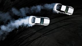 Aerial top view two cars drifting battle on race track, Two cars. Battle drift, Race cars view from above royalty free stock photography