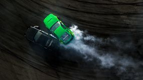 Aerial top view two cars drifting battle on race track, Two cars. Battle drift, Race cars view from above royalty free stock images