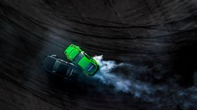 Aerial top view two cars drifting battle on race track, Two cars. Battle drift, Race cars view from above royalty free stock image