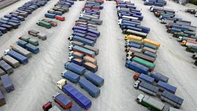 Aerial Top View of White Semi Truck with Cargo Trailer Parking with Other Trucks on Special Parking Lot. Shot on Phantom stock video footage