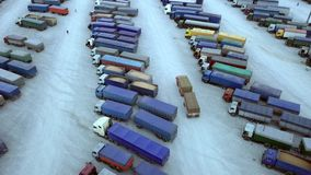 Aerial Top View of White Semi Truck with Cargo Trailer Parking with Other Trucks on Special Parking Lot. Shot on Phantom. 4K UHD Camera stock footage