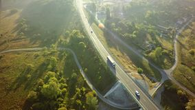 Aerial Top View of White Truck with Cargo Semi Trailer Moving on. Road in Direction royalty free stock photography