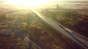 Aerial Top View of White Truck with Cargo Semi Trailer Moving on. Road in Direction royalty free stock photos