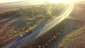 Aerial Top View of White Truck with Cargo Semi Trailer Moving on. Road in Direction royalty free stock images