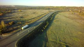 Aerial Top View of White Truck with Cargo Semi Trailer Moving on. Road in Direction stock image