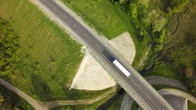 Aerial Top View of White Truck with Cargo Semi Trailer Moving on Road in Direction.  royalty free stock images