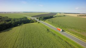 Aerial Top View of White Truck with Cargo Semi Trailer Moving on Road in Direction.  stock photos