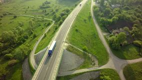 Aerial Top View of White Truck with Cargo Semi Trailer Moving on. Road in Direction f Loading Warehouse Area Royalty Free Stock Photos