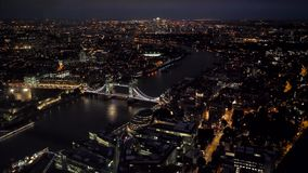 Aerial top view wide angle night panorama of London City and Tower Bridge. UHD 4K stock footage