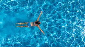 Aerial top view of woman in swimming pool water from above, tropical vacation Royalty Free Stock Photography