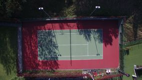Aerial Top Wiev Tennis. Two Young people playing Tennis. The end of the match, squeeze hands one at a time.  stock footage