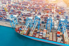 Free Aerial Tope View - Heavy Huge Ship With A Lot Of Containers Moored At The Pier In The Port, Loading With Cranes In The Industrial Royalty Free Stock Photography - 153497427