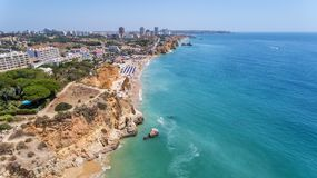 Aerial. Tourist beaches of the Portuguese city of Portimao. Shooted by drones. Algarve stock images
