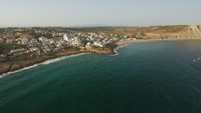 Aerial. Tourist village Luz, with views of the sky over the sea. stock footage