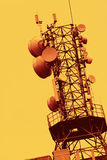 Aerial tower. An communications aerial tower on yellow background Stock Image