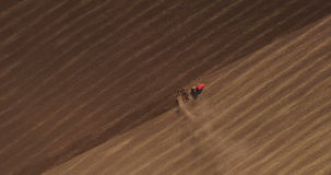 Aerial of tractor on harvest field stock video