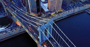 Aerial footage, traffic cars on the bridge and under the bridge in the evening in New York 4K. Aerial, traffic cars on the bridge and under the bridge in the stock video
