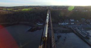 Aerial: Train on Forth Rail Bridge in Queensferry, Edinburgh, Scotland stock video footage