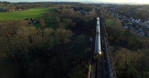 Aerial: Train on Forth Rail Bridge in Queensferry, Edinburgh, Scotland.  stock video footage