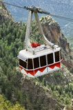 Aerial Tramway. An aerial tramway carries riders to the top of a rugged mountain range Stock Photo