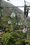 Aerial tramway. Cable car cabins at Hong Kong's Ocean Park theme park come over the top and down the side of a steep mountain stock photography