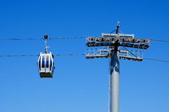 Aerial tramway. An aerial tramway cabin over the sky Stock Images